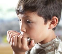 Boy playing harmonica 3