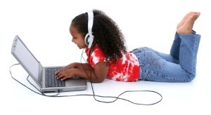 Girl with laptop and headphones i